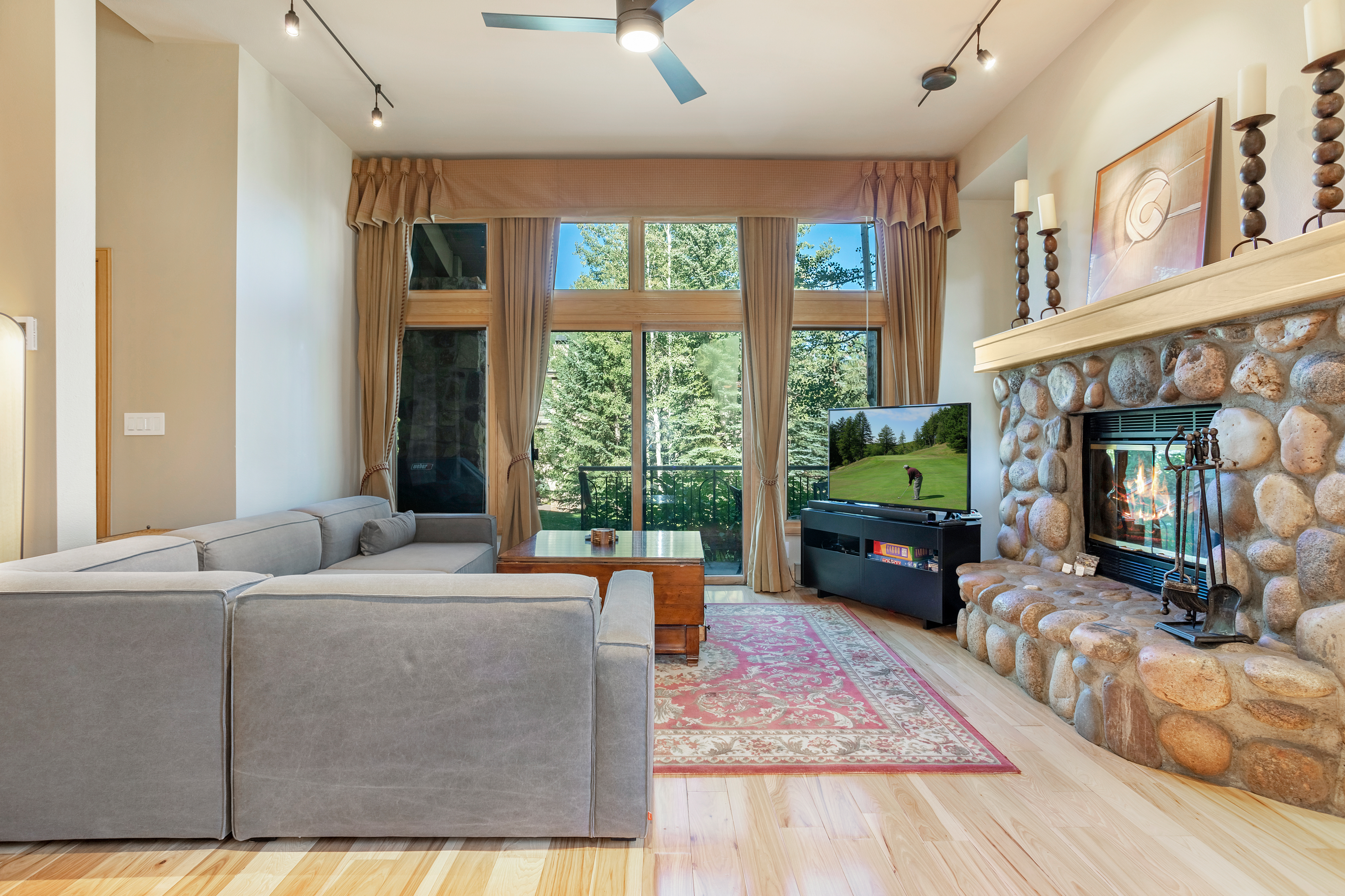 beaver creek townhome living room with windows and rock fireplace