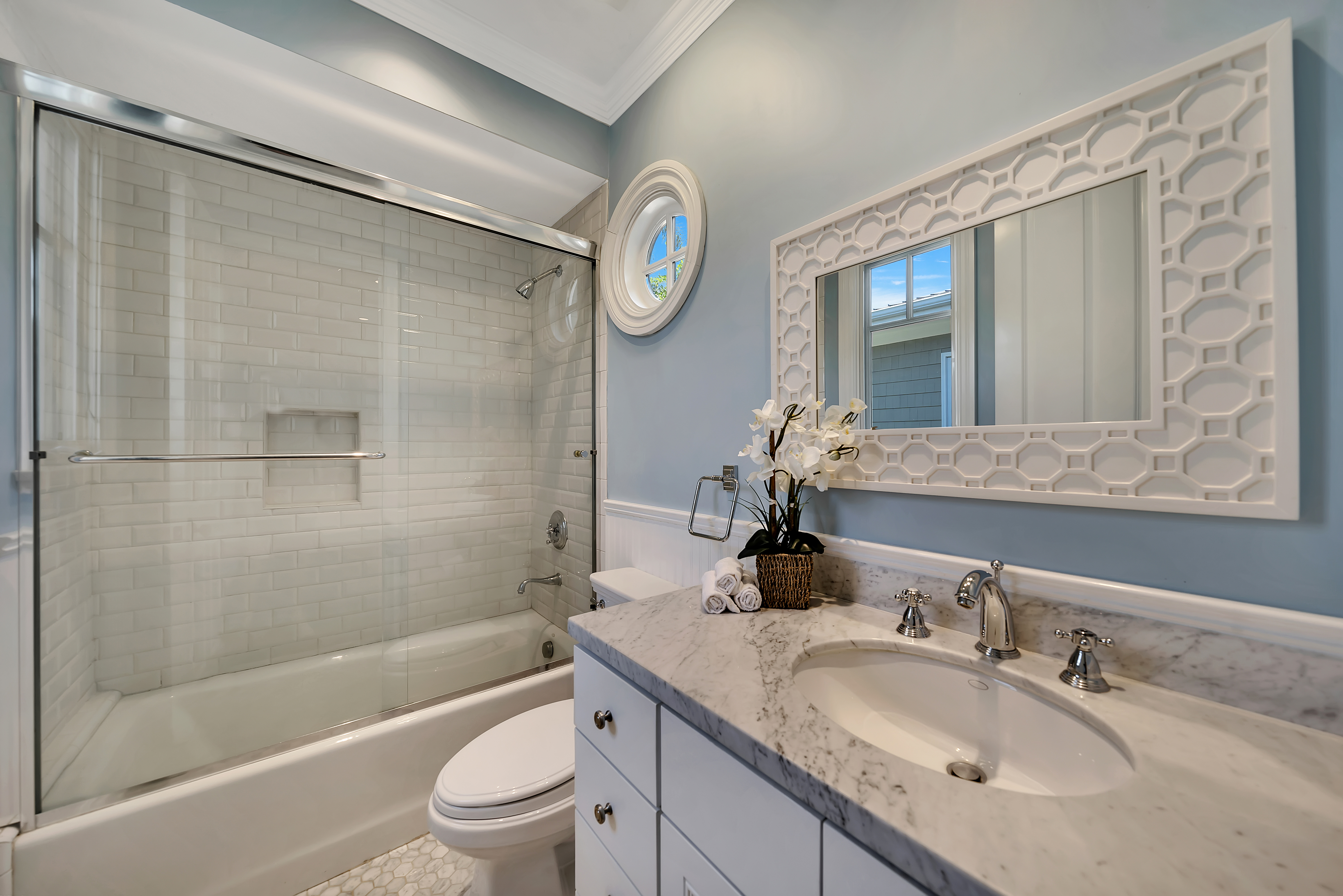 white subway tile in a bathroom