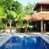 - Private and Elegant- Stunning 2 Story Home w/ Pool– Half Acre Lot- Walk to Beach