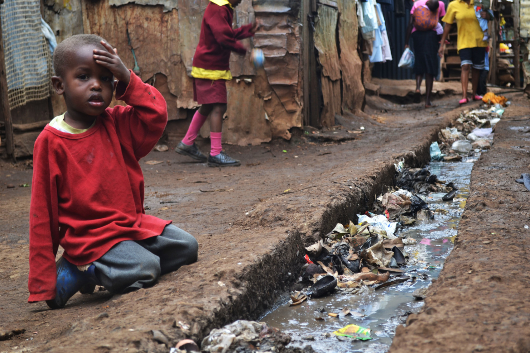https://s3.amazonaws.com/providencejournal/wp-content/uploads/A_young_boy_sits_over_an_open_sewer_in_the_Kibera_slum_Nairobi-e1452875547488.jpg