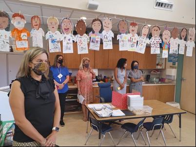 Principals observing at a classroom
