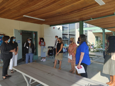 Principals gathering outside a classroom