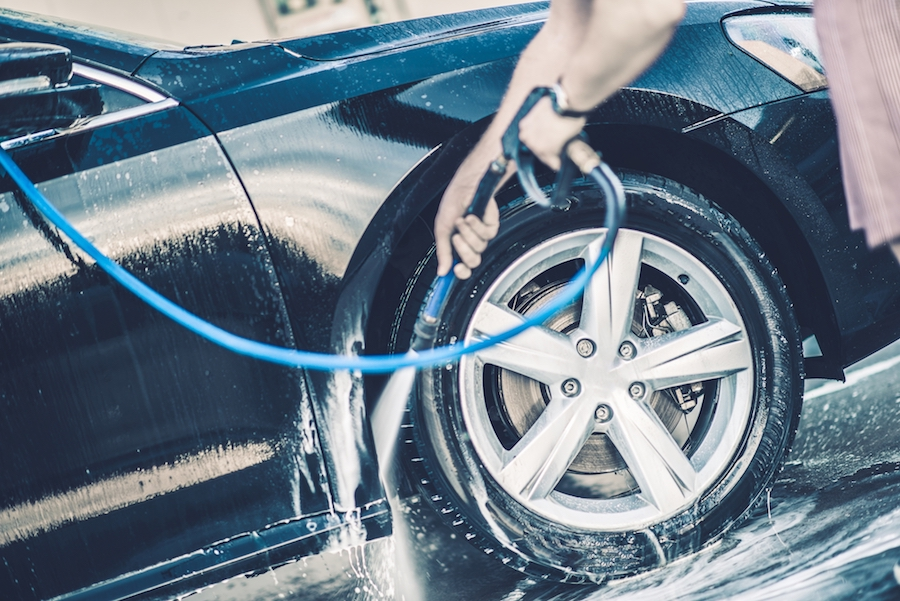 Self Car Washing. Cleaning Wheels Using High Pressure Water.