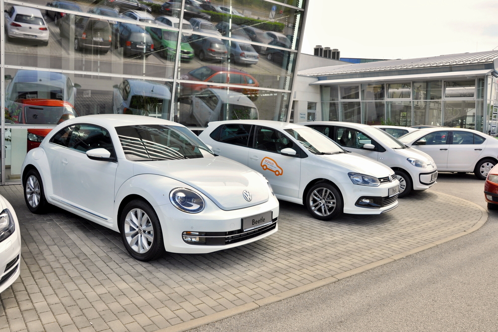 PRAGUE, THE CZECH REPUBLIC, 02.08.2015 - Brand new white Volkswagen Beetle parking in Prague with other VW cars in front of Car Store Volkswagen