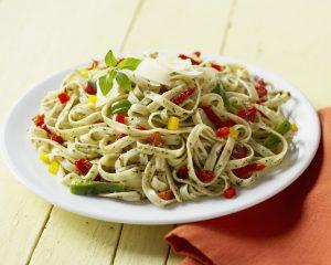 Pea Pesto Pasta with Sun-Dried Tomatoes and Arugula