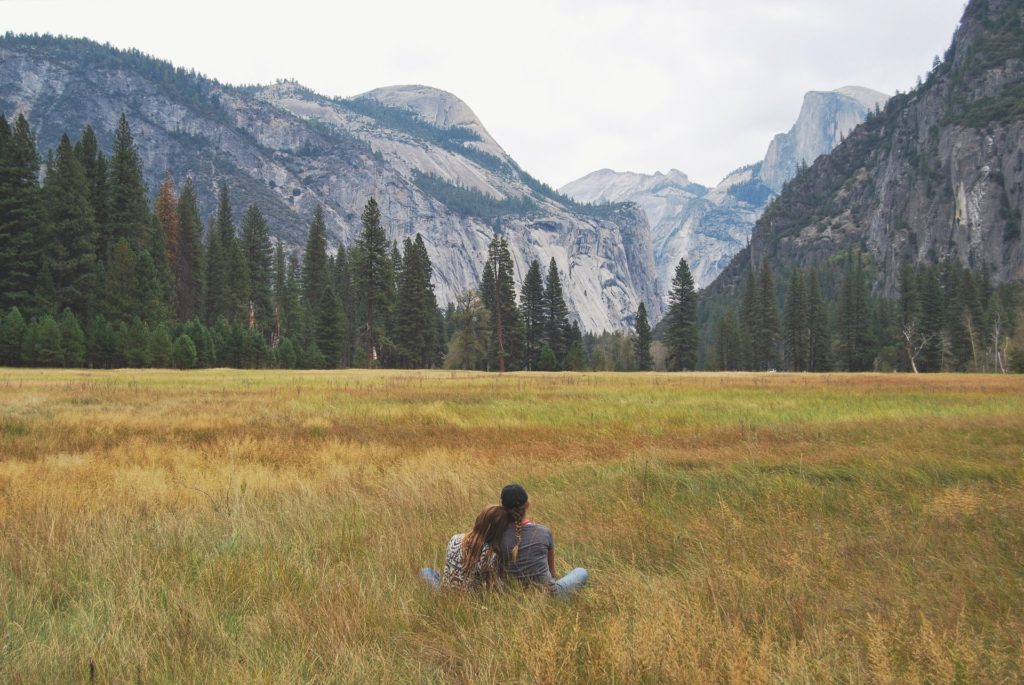 image of two people looking at yosemite valley