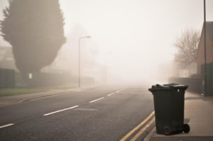 image of road and garbage can