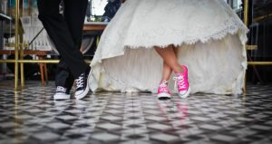 image of tennis shoes in wedding dress and tux
