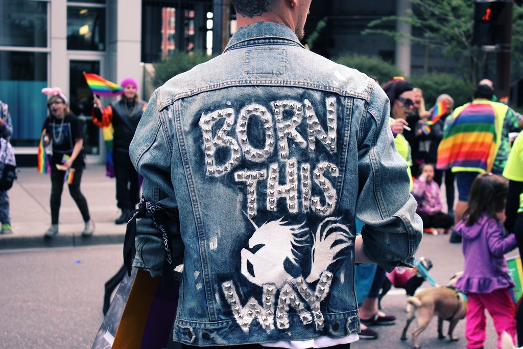 image of pedestrian wearing a jacket with words born this way