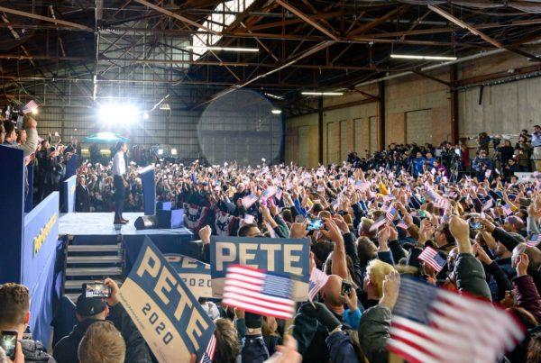 image of Pete Buttigieg, April 14, 2019, announcing presidential candidacy in front of crowd with signs for Pete 2020