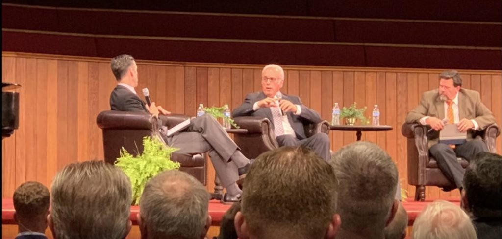 image of john macarthur on stage in chairs