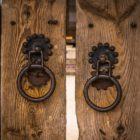 image of wooden door with large metal handle