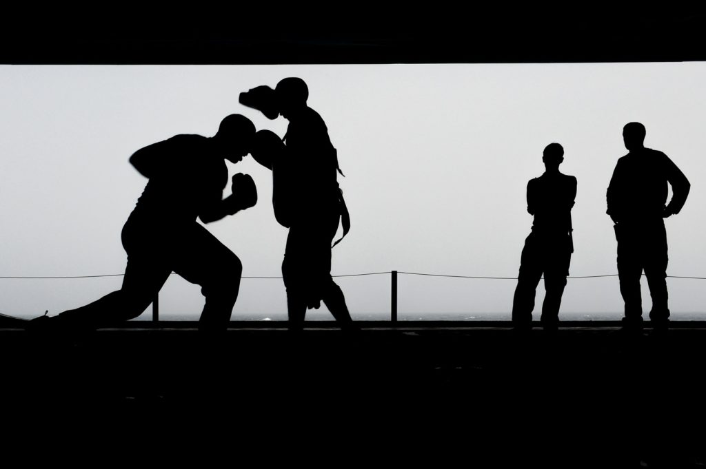 silhouette of boxing training with two onlookers