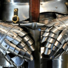 image of knight armor holding sword in front of groin