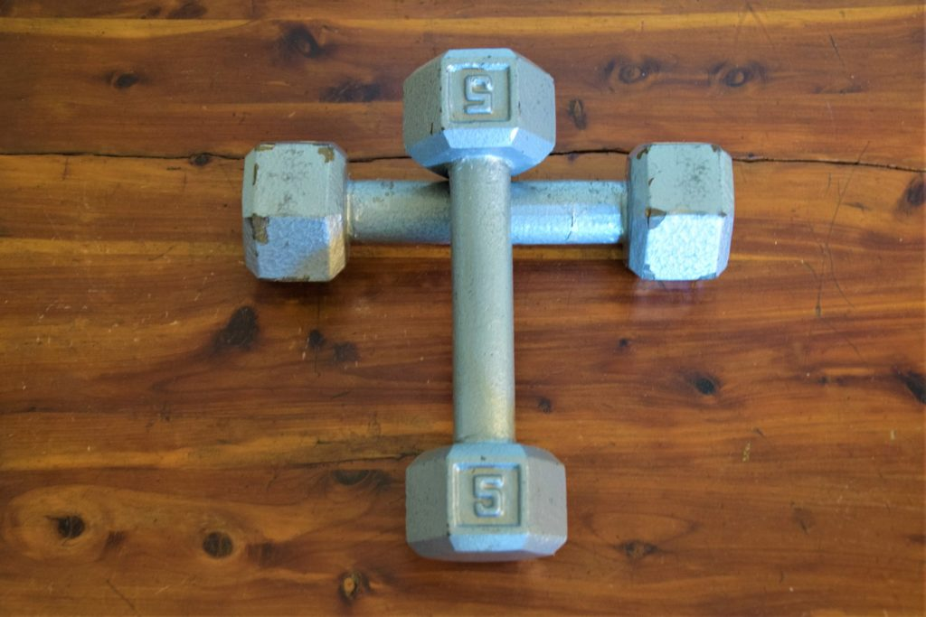 image of cross made out of barbells