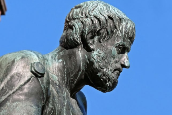 bust of Aristotle against a bright blue sky