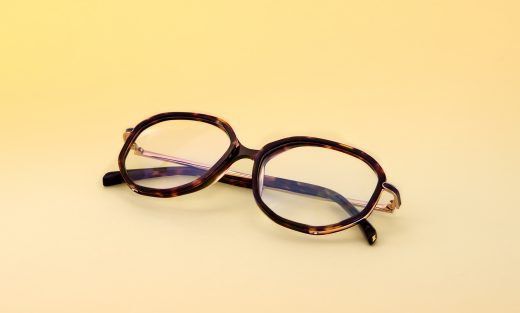 Photograph Of Maje's MJ1018 Optical Glasses On A Yellow Background