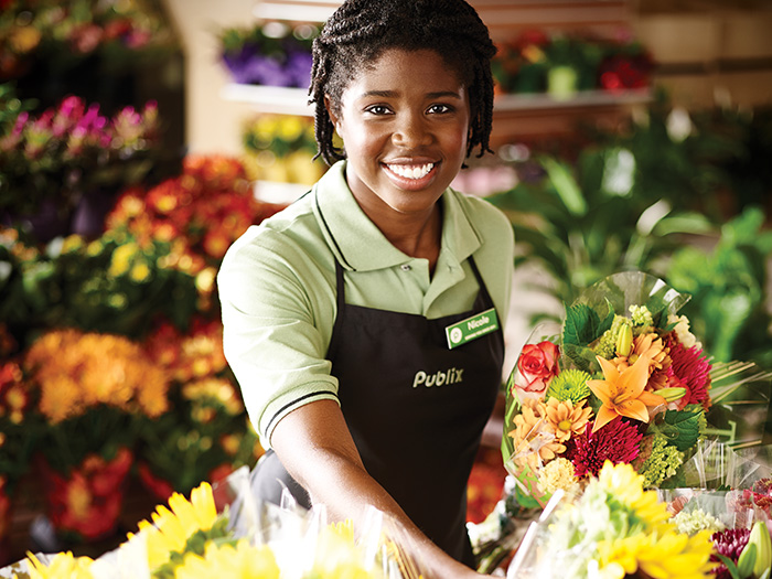 Publix Associate with fresh flowers