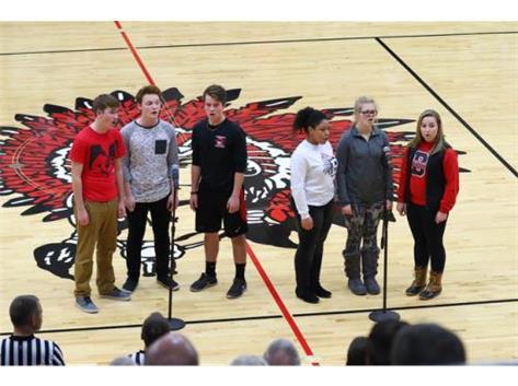 Choir Members sing National Anthem