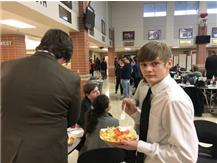 Judson Palmer enjoys a walking taco while waiting for finals postings at Chatham.