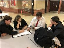 Trevor Richardson, Piper Chambers, Connor Fauset, and Stephen Lake create entertaining games as they wait for finals postings at Chatham.