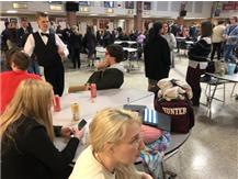 Trey Murphy, Hunter Rechsteiner, Macy Shelton, Alyssa Sawyer, and Judson Palmer wait to head to the auditorium for awards after competing in finals.