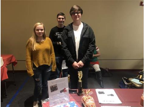 Alyssa Sawyer, Stephen Lake, and Hunter Rechsteiner promoting our fall Yankee Candle fundraiser at the Benton Civic Center Craft Show.