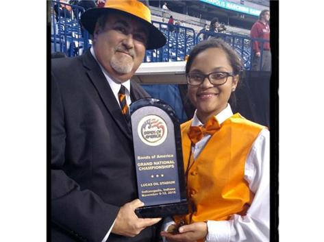 Holding the Champions Trophy at the IPS MFA BOA Marching Band Competition held on Nov. 9, 2016.