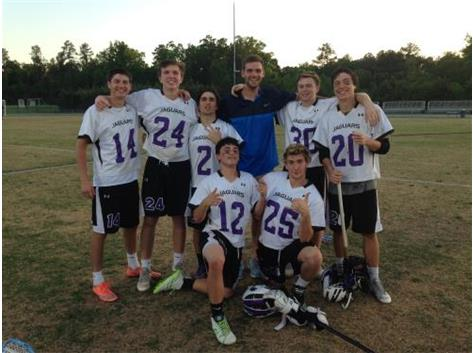 Carrboro lacrosse seniors pose after a victory on 2016 Senior Night