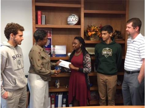 Carrboro Jaguars, Ryan Laatz, Niya Fearrington and Jonas Herfarth present $1500 check to Commissioner Tucker and Assistant Commissioner Alverson for the Hurricane Matthew Relief Fund