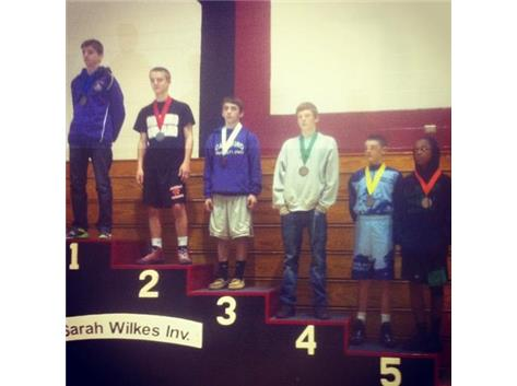Dante Veltri (Freshman) takes 3rd place in the 106 lbs division.