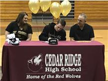 Hunter March signs a letter of intent to run track at UNCP.