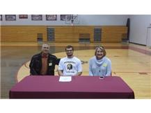 Luke Hernandez signs with Pfeiffer for Lacrosse.