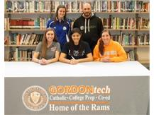 Melanie Claudio with Judson College coaches after signing her letter of intent