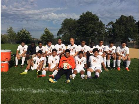 The team gets together on the bench to take a team picture before the first home game of the season against Guerin Prep.