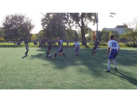 Jason Garcia carries the ball through the defense.