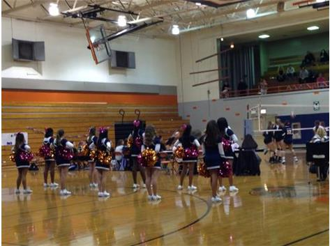 Cheerleaders cheer on the Girls Volleyball team on Senior Night