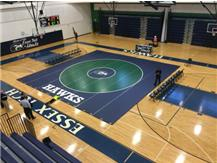 Hawks get first win ever opening the new gym on their new mat.