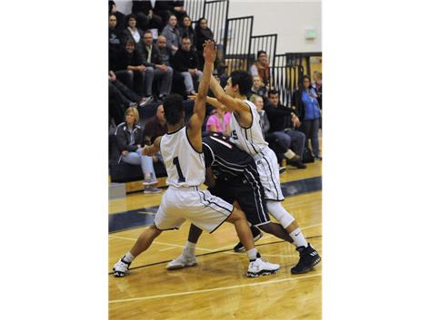 Sophomore Kendall Hersey and Junior Jose Tavares with Great defense against conference rival Lynn Tech