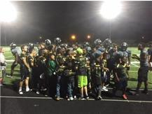 The Mustangs celebrate a victory with Future Mustangs