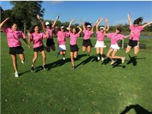 JV golfers jumping for going PINK!