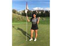 Kathryn sinks a hole-in-one at Prairie Club's 124 yard 7th hole.