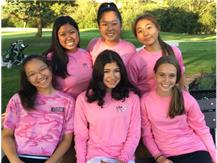 JV golfers proudly wearing their pink shirts.  We're all smiles after our win against NW!