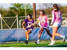 Lila Frick, Class of 2019, takes a shot vs. New Trier in annual Cancer Awareness Game.