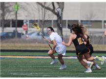 Senior Captain, Kate Brennan, handles the ball in game vs. Upper Arlington (OH).  April 6, 2019