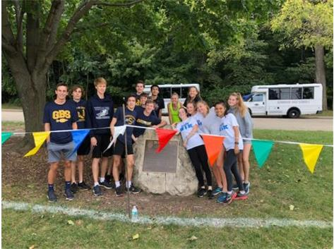 """The GBS Varsity Runners travel to Peoria every year to preview the state meet course.  Gathering near the finish by the """"Lacroix Rock"""" has become a great tradition after Friday's practice.  Hall of Fame Coach LaCroix helped bring the state meet to Peoria back in 1970's!"""