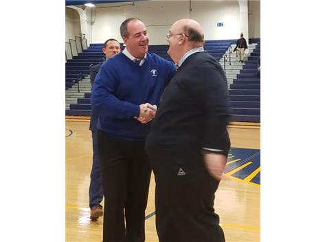 Wheaton North's athletic director congratulates Coach Wise for 21 great years at the Wheaton North tourney!