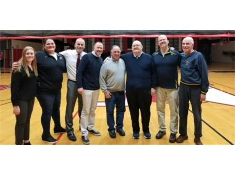 The Maine South coaching staff honors Coach Wise in a pregame ceremony on 1/8/2019
