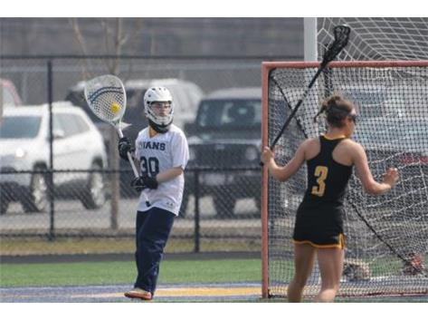 Senior Captain, Delaney Gallagher, looks to clear the ball in game vs. Upper Arlington (OH).  April 6, 2019