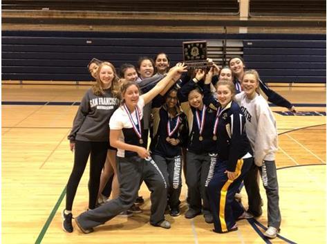 Team holding trophy high!